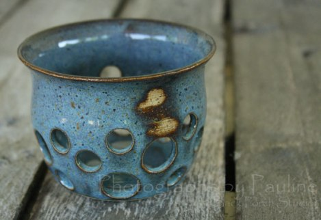 "Unique rustic blue luminary  with an ""imperfection"" ~ a couple of unglazed spots.The unglazed spots accentuates the beautiful light brown stoneware clay making this luminary truly one of a kind!"
