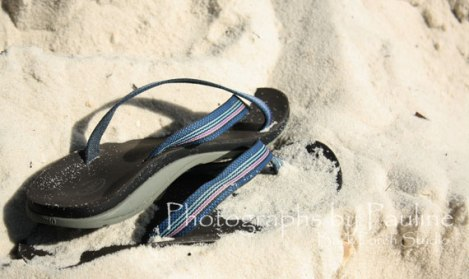 Shaking the sand off of my flip-flops.  Back to playing in the mud.