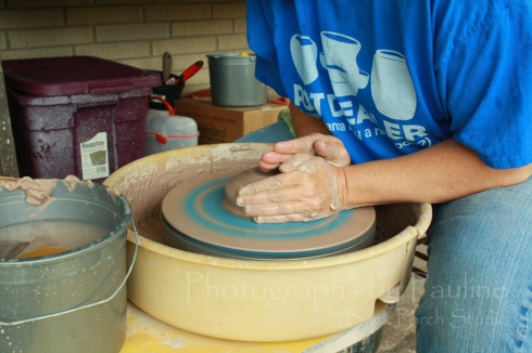 Pressing the clay down and out to the width of the pet dish - approximately 6 inches in diameter.
