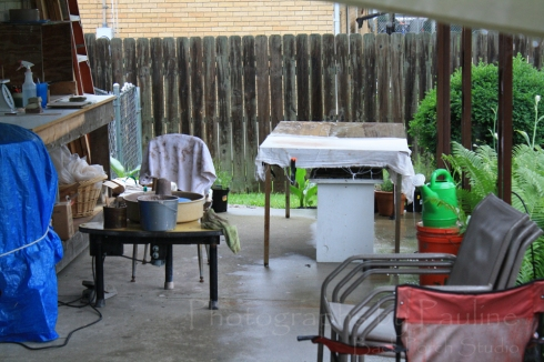 It rained and it poured!  You can see how far I had to scoot my wheel over due to the rain blowing into my back porch studio.