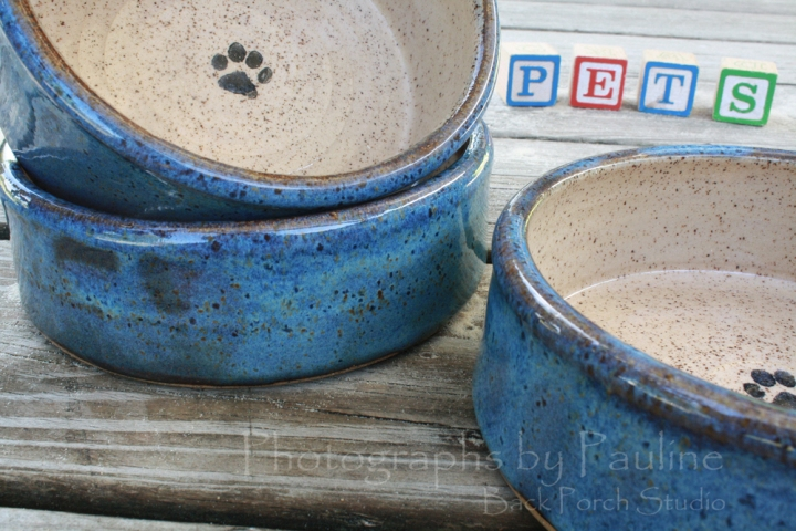 Blue and cream pet dishes available in various sizes.