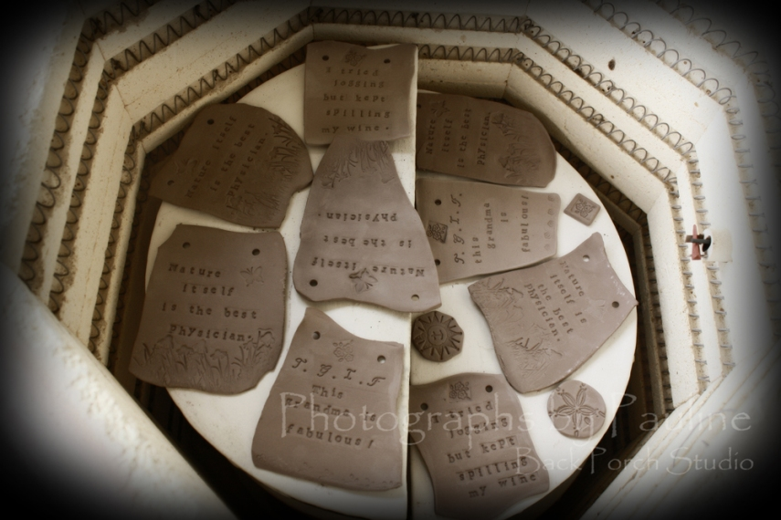 Whimsical Inspirational Wall Art Plaques in the kiln.