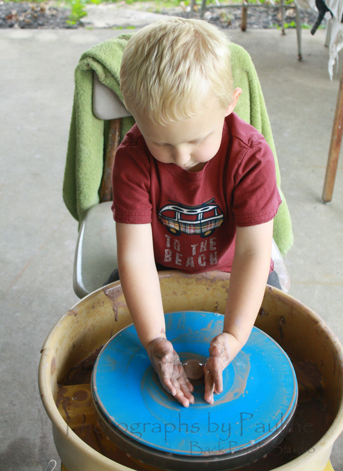 Little hands covered in mud too!