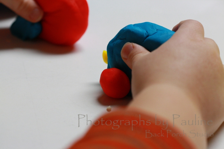 Another low light situation: our grandson playing with Play-Doh inside. I love the sharpness and clarity of the center of the picture while the edges are softly out of focus.